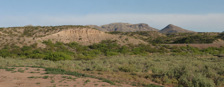 A panoramic shot of the Chupandera Unit. The area is marked by hills that house shrubs and bushes and is very dry.